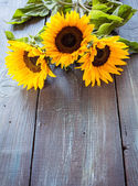 Sunflowers on table — Stock Photo