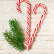 Knitted wool texture with christmas decoration and candy cane — Stock Photo #58956413
