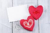 Hearts on white wood background — Stock Photo