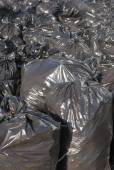 Pile of black garbage bags with tons of trash, vertical — Stock Photo