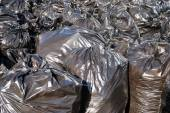 Pile of black garbage bags with tons of trash, horizontal — Stock Photo
