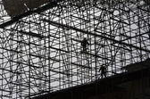 Workers assemble metal construction — Stock Photo