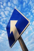 One way sign under blue sky — Stock Photo
