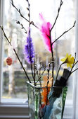Easter still life, willow branch and feathers in a vase — Fotografia Stock