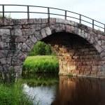 Ancient stone arch bridge — Stock Photo #78066800