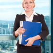 Business woman with folder in the office — Stock Photo #56003499