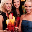 Happy girls drinking cocktails — Stock Photo #56003569