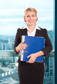 Business woman with folder in the office — Foto Stock