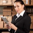 Businesswoman Using Digital Tablet In Distribution Warehouse — Stock Photo #57212333