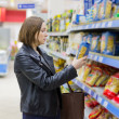 Woman checking food labelling — Stock Photo #73917039