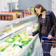 Woman checking food labelling — Stock Photo #73917083