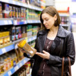 Woman checking food labelling — Stock Photo #73917145