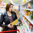 Woman checking food labelling — Stock Photo #73917471