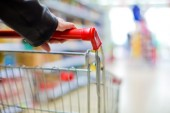 Female shopper with cart — Stock Photo