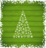 Christmas pine and border made of snowflakes on green wooden ba — Stockvector