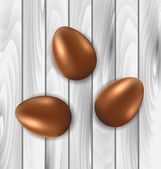 Easter chocolate three eggs on grey wooden background — Stock Vector