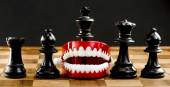 Taking a bite out of chess. — Stock Photo