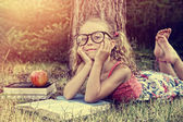 Vintage young girl with book — Stock Photo