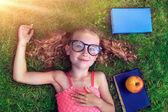 Joyful girl with book — Stock Photo