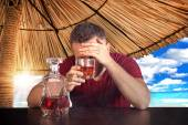 Drunk man in hotel resort bar with problems — Stock Photo