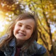 Joyful young girl smile in the sunny park — Stock Photo #57140985