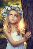 Warm summer days - a girl in a wreath — Stock Photo