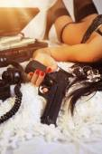Girl in lingerie with gun and money — Stock Photo