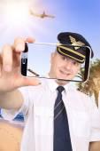 Pilot doing a Selfie on a hot beach — Stock Photo
