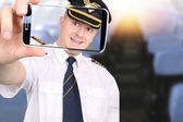 Pilot doing a picture in the aircraft cabin — Stock Photo