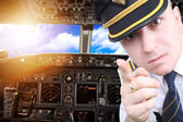 Furious pilot draws attention to the intolerable passengers — Stock Photo