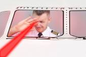 Pilot blinded by laser beam — Stock Photo