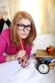 Joyful schoolgirl learns to exam — Stok fotoğraf