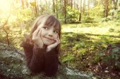 Joyful adolescent girl in the forest — Stock Photo