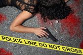 Murder on the street - a woman with a gun in the blood — Stock Photo