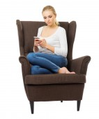 Young girl with mobile phone on chair — Stock fotografie