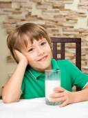 Little boy with milk — Stock Photo