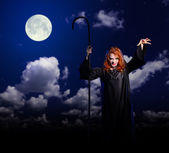 Witch girl on night sky background — Stock Photo