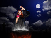 Witch with red potion and cauldron  at night sky backgroun — Stok fotoğraf