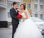 Newlyweds near the house — Stock Photo