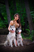 Girl with dogs at forest — Stock Photo