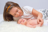 Baby with her sister — Stock Photo