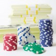 Gambling chips dices and heap of dollars — Stock Photo #65487471
