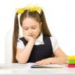Little schoolgirl at the table — Stock Photo #68010295