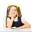 Little schoolgirl at the table — Stock Photo #68010553
