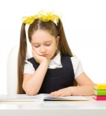 Little schoolgirl at the table — Stock Photo