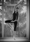 Dancing girl on window — Stock Photo