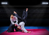 Fight between two martial arts fighters — Stock Photo
