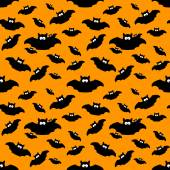 Halloween pattern with bats over orange background — Stock Photo