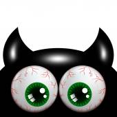 Halloween monster with green eyes with place for text — Stock Photo