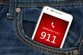 Mobile phone in pocket with emergency number 911. focus on scree — Stock Photo